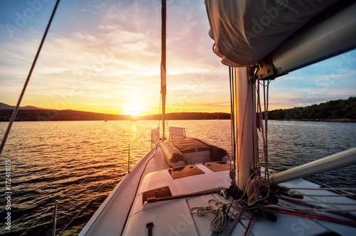 Close-up of yacht sailing against beautiful sunset