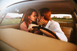 Pretty lovely couple kissing while sitting inside car