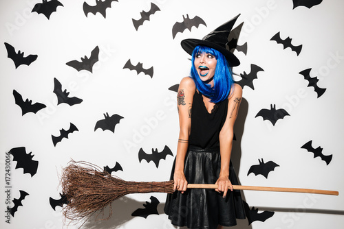 Photo sur Toile Art Studio Уmotional screaming young woman witch.