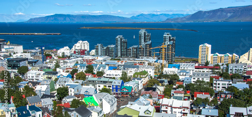 Fotografija  Beautiful super wide-angle aerial view of Reykjavik, Iceland with harbor and sky
