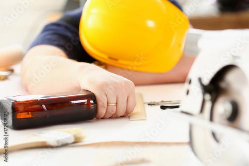 Stickers pour porte Bar Arm of drunken worker in yellow helmet