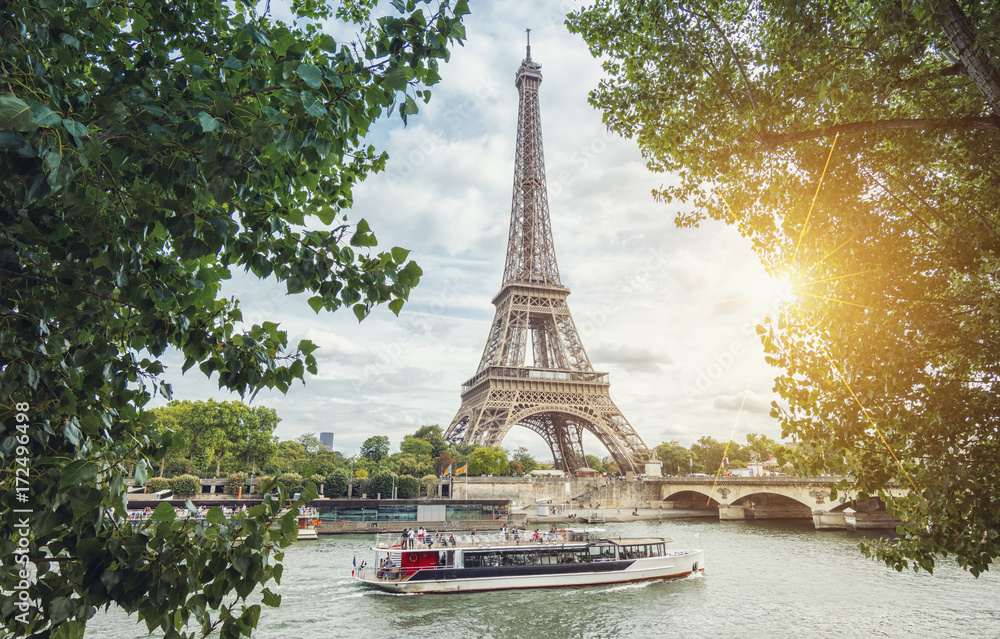 Paris Seine view with Eiffel tower and ship at summer