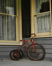 Old Tricycle On A Porch