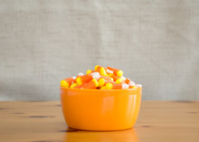 Candy Corn In An Orange Bowl On A Wooden Table