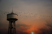 Water Tank Tower With Sunset