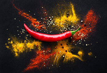 Fototapeta Do gastronomi Red hot pepper. a mixture of spicy seasonings. View from above