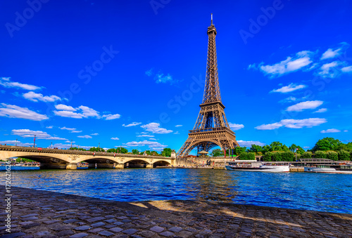 Poster Tour Eiffel Paris Eiffel Tower and river Seine in Paris, France. Eiffel Tower is one of the most iconic landmarks of Paris.