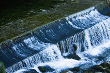 Small Dam With Water Flowing R...