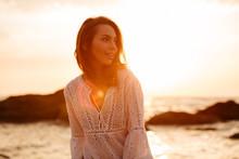 Beauty Brunette Woman In Light Summer Dress Posing On Beach