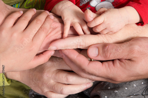 Family Baby Hands Father And Mother Holding Newborn Kid And Sister