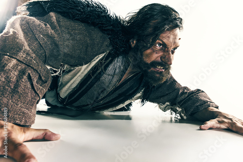Fotografía  Portrait of a brutal bald-headed viking in a battle mail posing against a white background