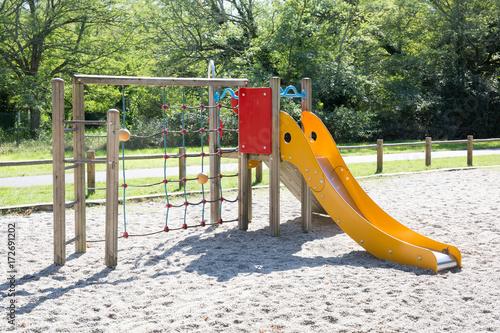 Obraz Big colorful children playground equipment in park - fototapety do salonu