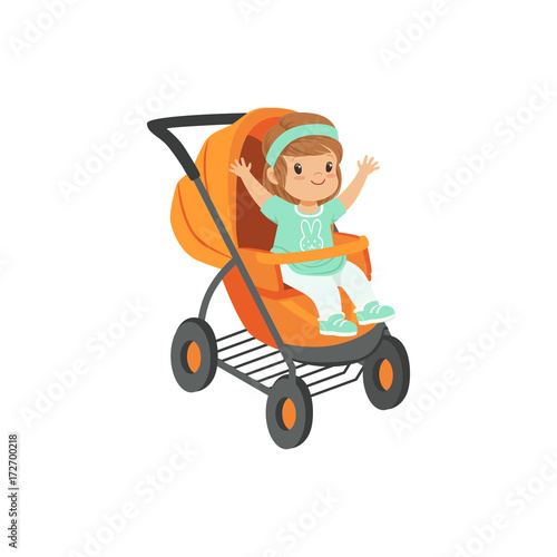 Photo  Adorable little girl sitting in an orange baby carriage, safety handle transport