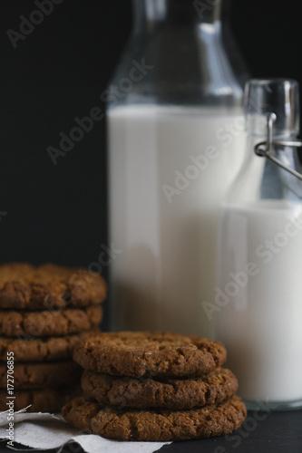 Spoed Foto op Canvas Koekjes Close-up of cookies and milk on table against black background