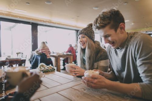 Friends Enjoy Coffee In Winter
