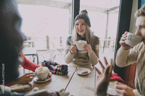 Friends Socialise In Winter Cafe