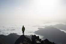 Silhouette Of A Young Man At The Top Of The Mountain With Sea Of Clouds On The Valley