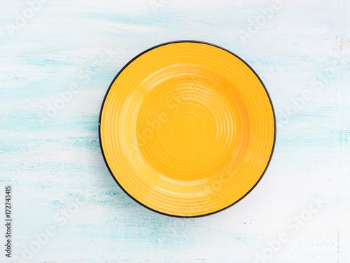 Staande foto Klaar gerecht Pastel Color yellow ceramic plate dish top view background