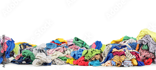 Fotografía  Big pile of clothes on a white background