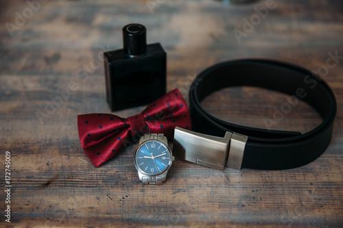 Staande foto Dragen Wedding groom accessories, details of clothes, belt, wristwatch, boutonniere, bow-tie, perfume.
