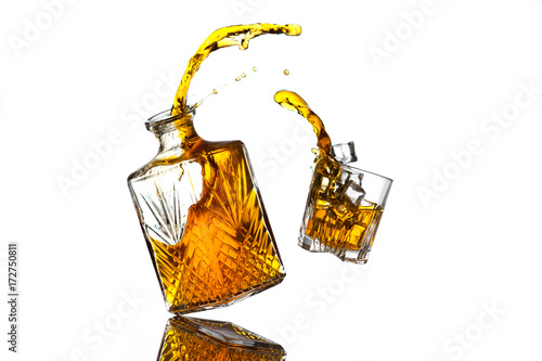 Foto op Canvas Alcohol Liquor bottle and glass in mid air