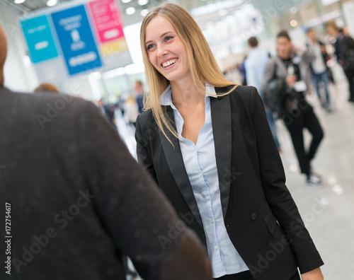 Fotografie, Obraz young beautiful businesswoman at a trade fair