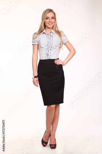 642a8980f3 business blond woman with straight hair style white blouse black skirt  stiletto heels shoes full body portrait isolated on white