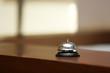 Service bell on reception desk in hotel