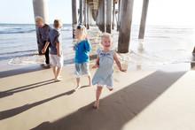 Kids Playing Near Beach Pier Laughing
