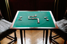 Dominoes Strategy Game On Felt Table