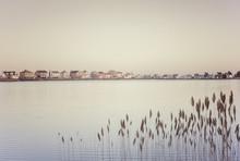 Calm Pond With Beach Homes