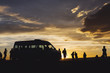Silhouette of a group of Travellers enjoying sunset