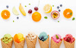 canvas print picture - Various of ice cream flavor in cones blueberry ,strawberry ,pistachio ,almond ,orange and cherry setup on white wooden background . Summer and Sweet menu concept.