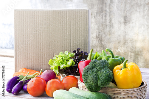 Food Delivery service: Vegetable delivery at home online order for cooking and packages box with blank for text. on wooden table background. © nicemyphoto