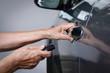 Elderly woman hand open the car on key car alarm systems