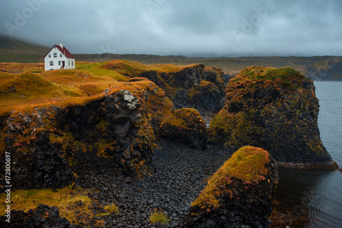 Landscape of Iceland, lonely house on the ocean, fog and rain Canvas Print