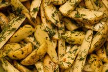 Fried Potato Wedges Closeup Ba...