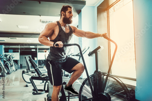 Man Using Exercise Bike At The Gym Fitness Male Air For Cardio Workout