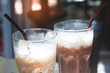 Close up of iced coffee and iced chocolate in glasses