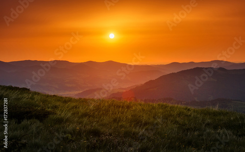 Spoed Foto op Canvas Oranje eclat Majestic sunset in the mountains landscape.