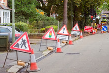 Roadwork Signs Line Up On A St...