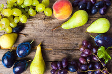 Various Fruits On Rustic Wooden Background