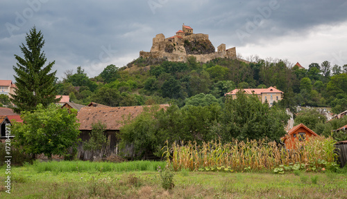 Papiers peints Con. Antique Rupea Castle near Brasov, medieval fortress in Romania with gray clouds