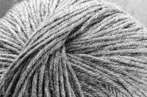 Fotografie, Obraz  A ball of woolen yarn.- in black and white.