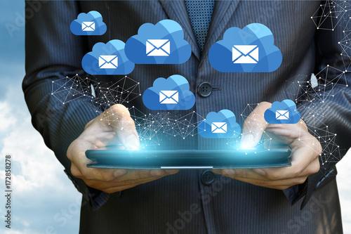 Businessman showing cloud emails .