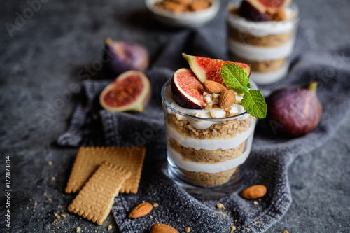 Layered mascarpone dessert with crushed vanilla biscuits, figs and almonds