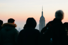 Silhouette Of Tourists And View Of Empire State Building