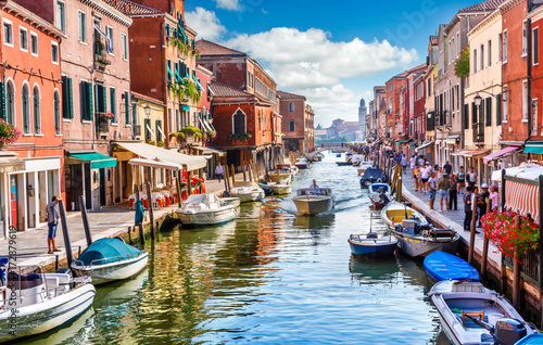 Fototapeta Island murano in Venice Italy. View on canal with boat obraz