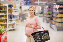 Pregnant Woman With Shopping B...