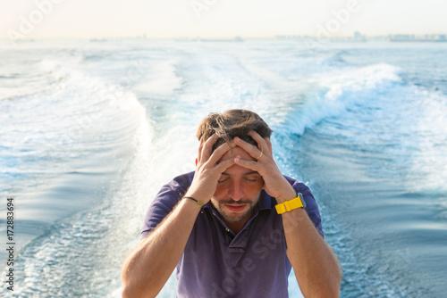 Fotografía  portrait of depressed young boat crew